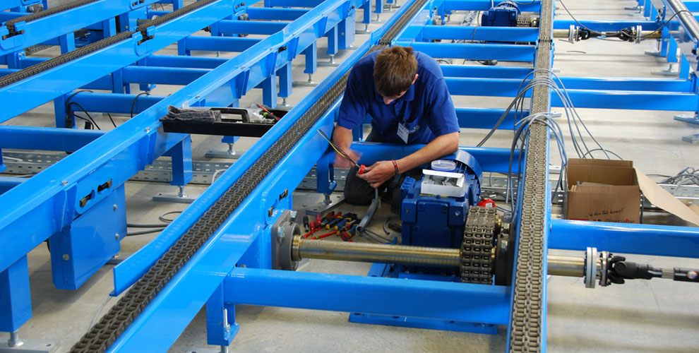 employees in the assembly of conveyor systems