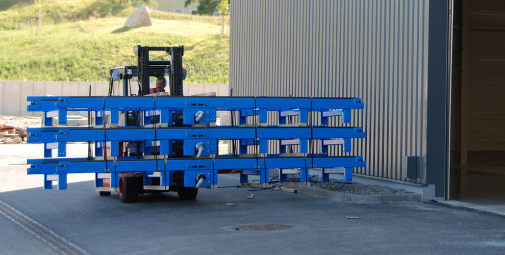 blue parts of a conveyor system on lift trucks