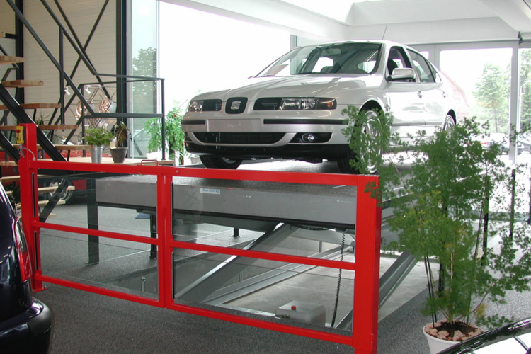 silver car on lift table