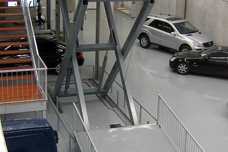 extended lift table in car dealership